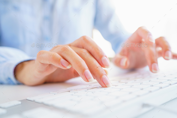 Female woman office worker typing on the keyboard - Stock Photo - Images