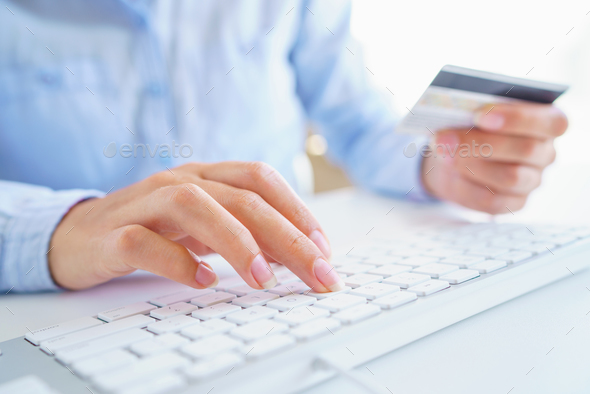 Woman using a credit card for online payments. The concept of on - Stock Photo - Images