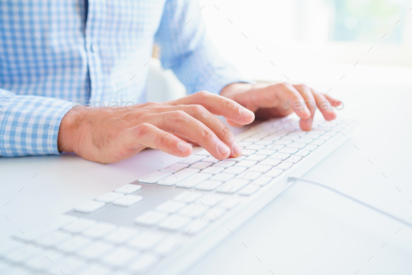 Men office worker typing on the keyboard - Stock Photo - Images