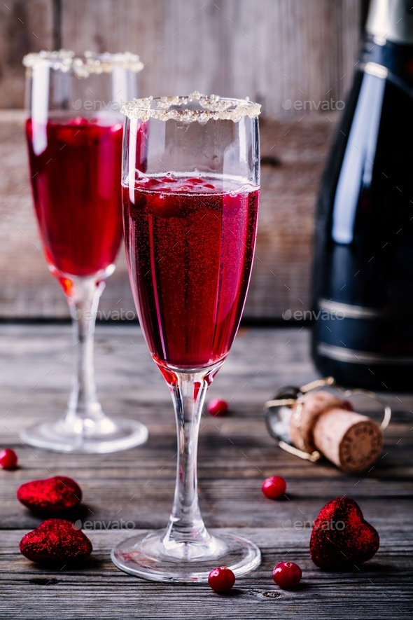 Refreshing cocktail with sparkling wine and cranberry for Valentine's day - Stock Photo - Images