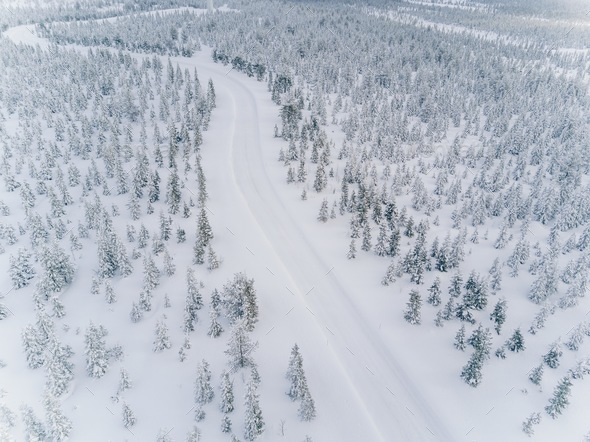 Aerial drone view of road in idyllic winter landscape. - Stock Photo - Images