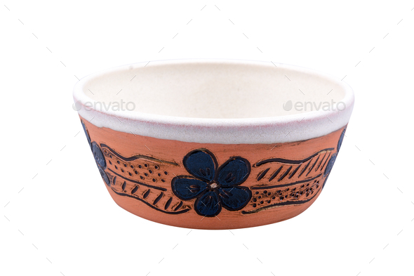 Clay bowl decorated with a flower on a white background - Stock Photo - Images