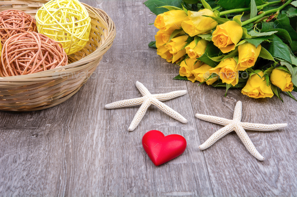 Starfishes, heart and roses on a wooden table - Stock Photo - Images