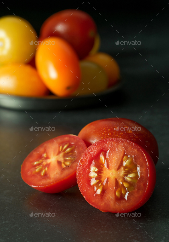 A Freshly Cut Red Tomato - Stock Photo - Images