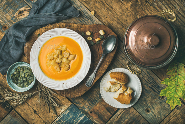 Fall pumpkin cream soup with croutons and seeds - Stock Photo - Images