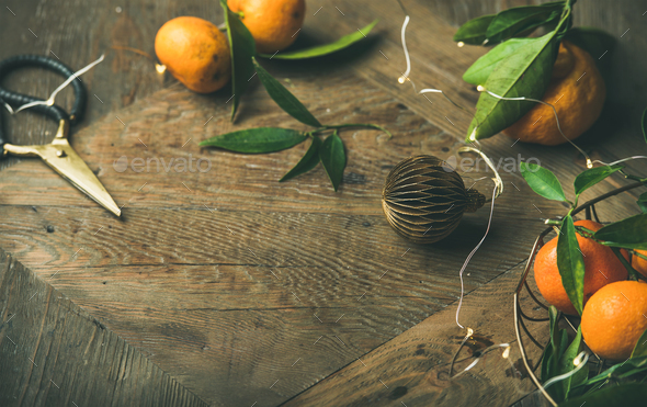 Fresh tangerines with leaves and decoration toys over table - Stock Photo - Images