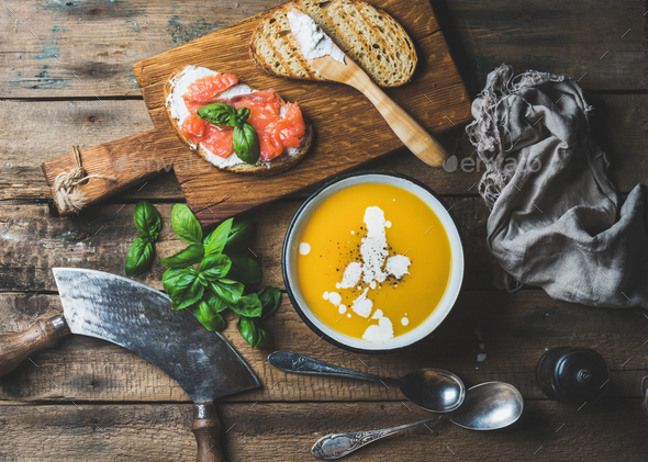 Dinner or lunch with pumpkin cream soup and toasts - Stock Photo - Images