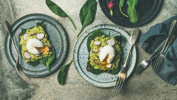 Healthy vegetarian breakfast flat-lay. Avocado and egg toasts, wide composition - Stock Photo - Images