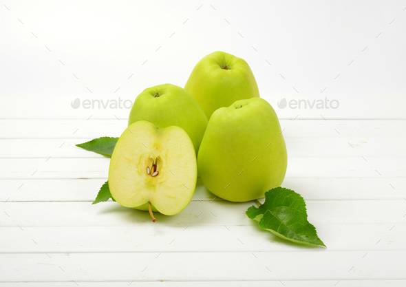 Three and a half green apples - Stock Photo - Images