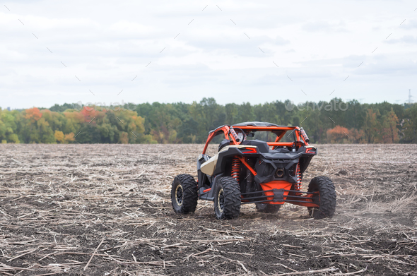 Quad bike of red color shot from behind - Stock Photo - Images