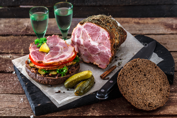 Rye burger with smoked ham, pickles and two glasses of vodka - Stock Photo - Images