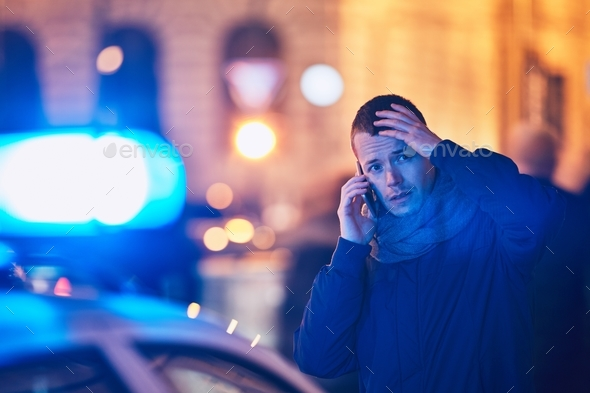 Young man calling after a crisis situation - Stock Photo - Images