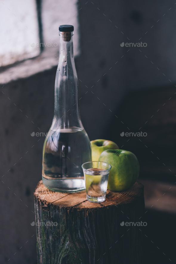 Apple brandy, rustic retro atmosphere - Stock Photo - Images