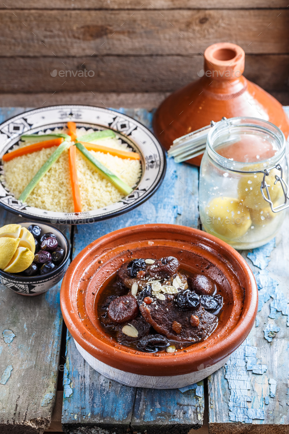 Delicious Moroccan tajine with beeef, prunes, raisins, figs and almonds - Stock Photo - Images