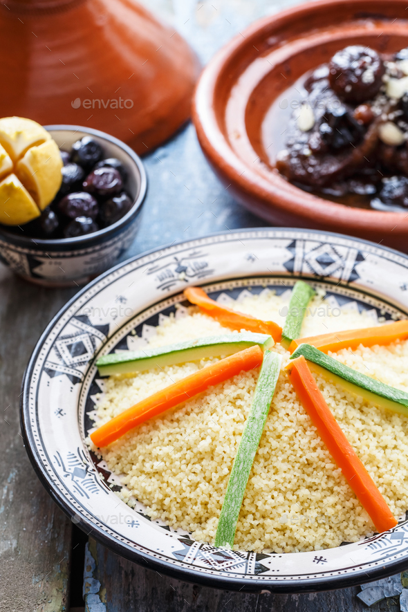 Moroccan couscous topped with vegetables. Rustic style. - Stock Photo - Images