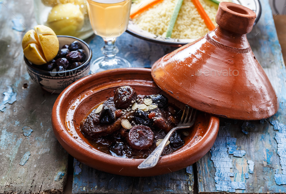 Slow cooked beef with prunes, figs, raisins and almonds - moroccan tajine. - Stock Photo - Images