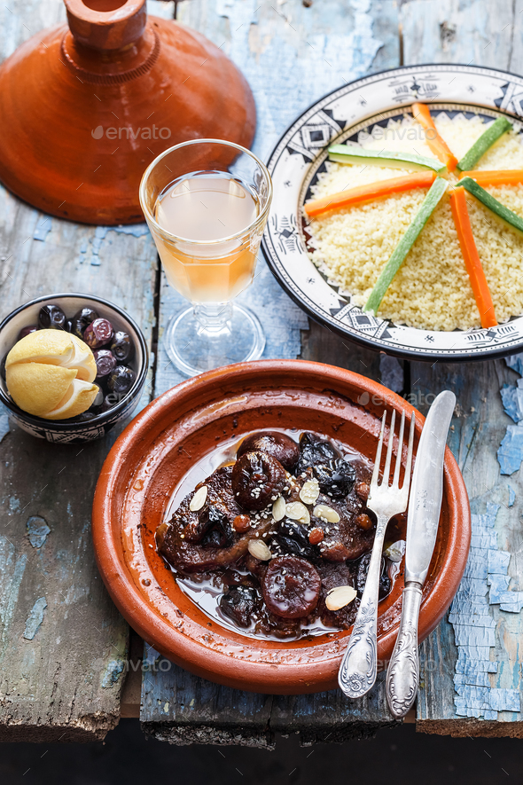 Beef tajine with olives, couscous and salted lemons. Morrocan dishes. - Stock Photo - Images