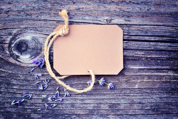 Lavender flowers (Lavandula) with paper tag on an old wooden tab - Stock Photo - Images