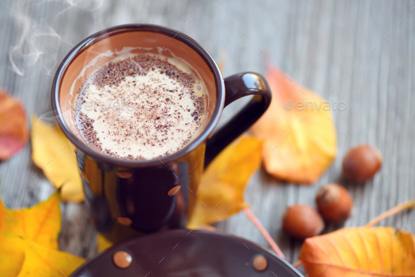 Coffee cup on the autumn fall leaves and wooden surface backgrou - Stock Photo - Images