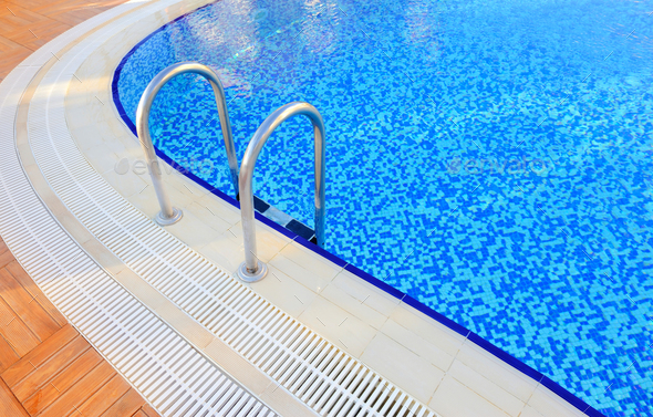 Swimming pool with stair at hotel close-up - Stock Photo - Images