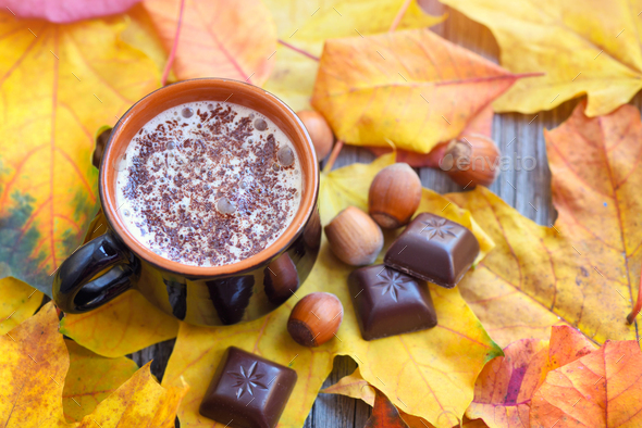 Autumn Cup of coffee, nuts, chocolate and autumn leaves. Autumn - Stock Photo - Images