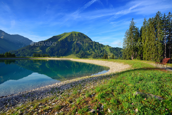 Idyllic summer landscape with mountain lake in the Alps - Stock Photo - Images