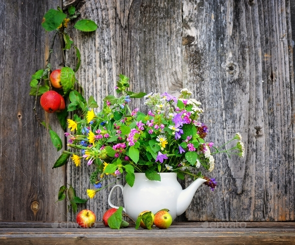 Autumn bouquet of wild flowers and apples - Stock Photo - Images