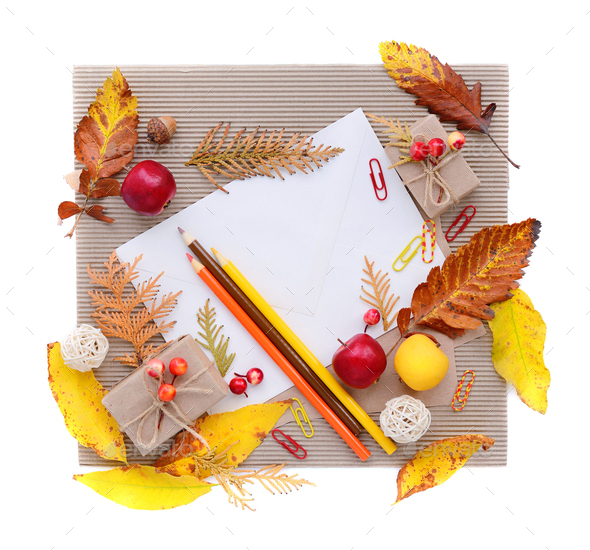 Autumn background with white envelope, colour pencils and autumn - Stock Photo - Images