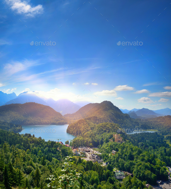 Beautiful view of the alpine lake Alpsee. Sunny summer day in th - Stock Photo - Images