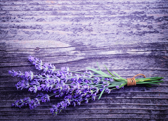 Lavender flowers (Lavandula) on an old wooden background - Stock Photo - Images