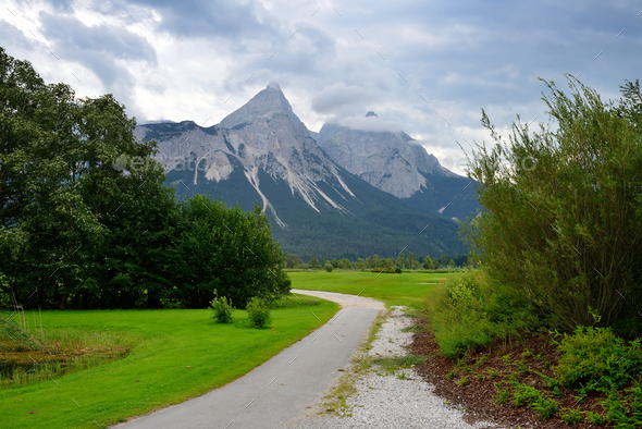 Country road at the european alps. Summer mountain landscape - Stock Photo - Images