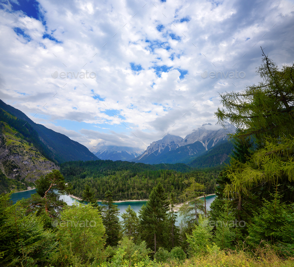 View into beautiful mountain lake in the Alps. Dramatic and pict - Stock Photo - Images