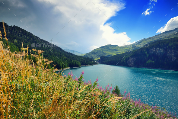 Beautiful view of the emerald alpine lake. Dramatic and pictures - Stock Photo - Images