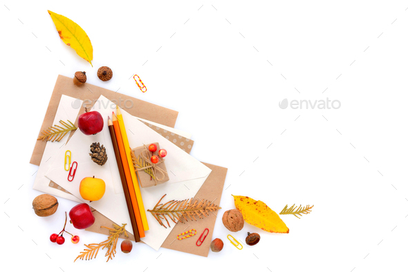 Background with autumn leaves, pencils and envelopes. Top view. - Stock Photo - Images