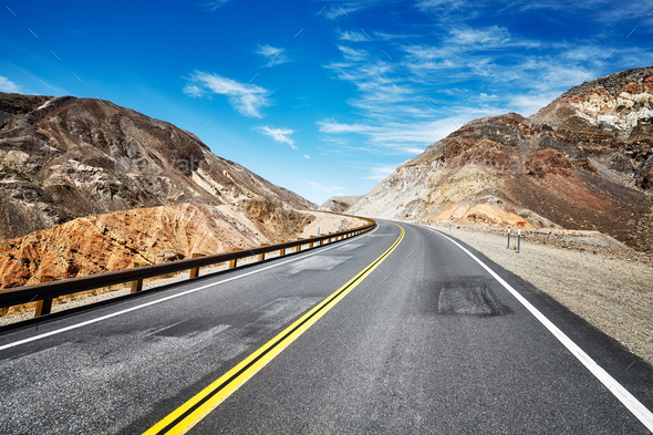 Empty highway in deserted mountainous terrain, USA. - Stock Photo - Images