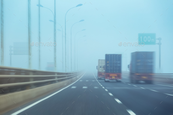 container trucks in fog - Stock Photo - Images