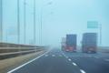 container trucks in fog - PhotoDune Item for Sale
