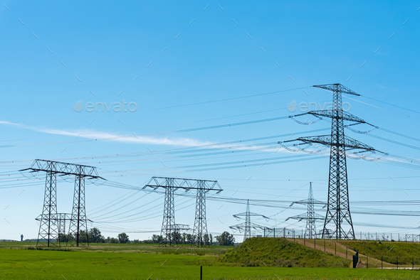 Electric pylons and power transmission lines - Stock Photo - Images