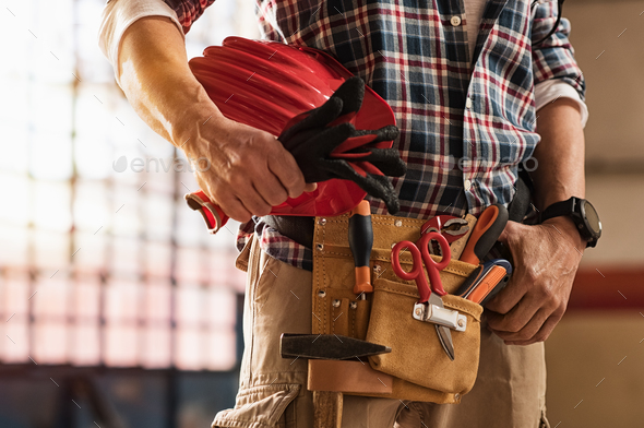 Bricklayer holding construction tools - Stock Photo - Images