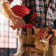 Bricklayer holding construction tools - PhotoDune Item for Sale