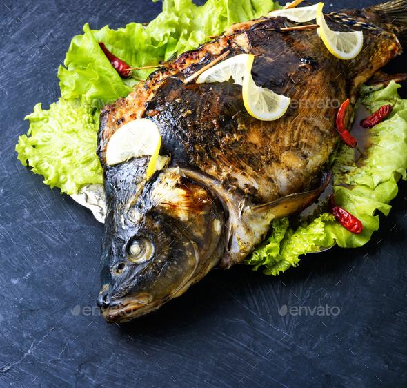 baked stuffed fish - Stock Photo - Images