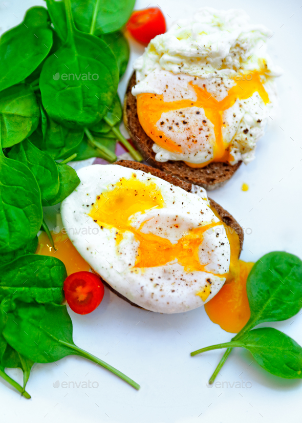 Tasty poached eggs - Stock Photo - Images
