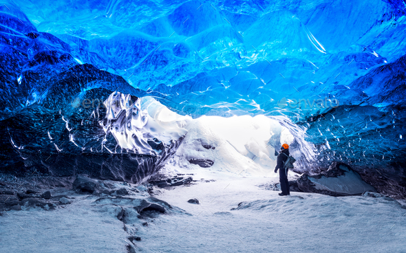 Traveler in ice cave - Stock Photo - Images