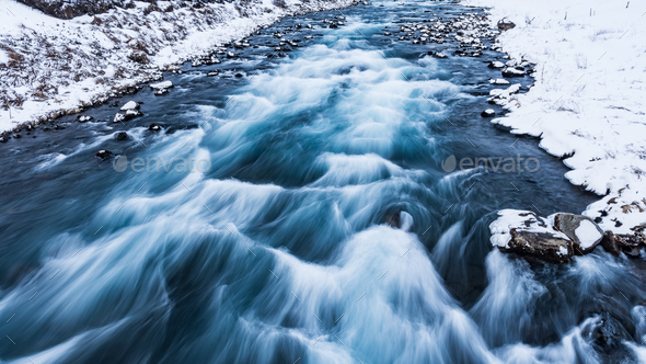 Drifting river in Iceland - Stock Photo - Images