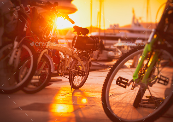 Bicycles in sunset light - Stock Photo - Images