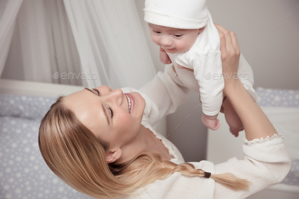 Happy mother with her baby - Stock Photo - Images