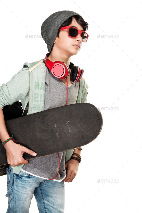 Skateboarder over white background - Stock Photo - Images
