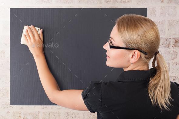 Student girl near blackboard - Stock Photo - Images