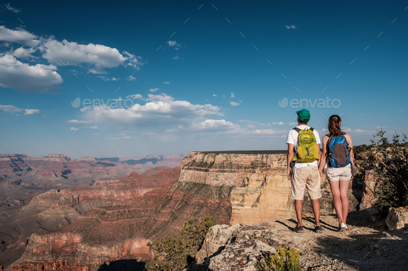 Tourists with backpack hiking at Grand Canyon - Stock Photo - Images