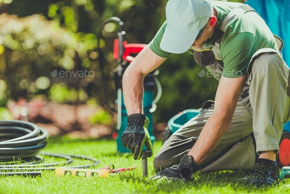 Grass Sprinklers Installation - Stock Photo - Images